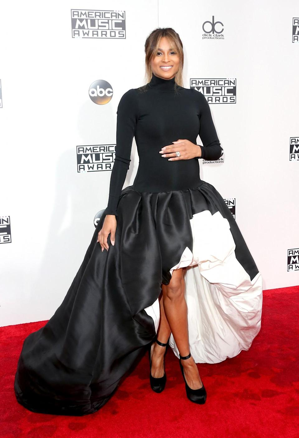 <p>Ciara's puffball skirt put emphasis on her legs rather than her bump with her black rollneck hiding it from sight completely. <i>[Photo: Getty]</i> </p>