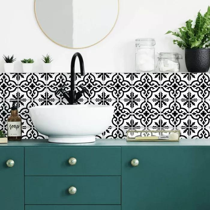 """<p><strong>Target</strong></p><p>target.com</p><p><strong>$35.99</strong></p><p><a href=""""https://www.target.com/p/ornate-tile-backsplash-peel-and-stick-giant-wall-decal-black-white-roommates/-/A-82669176"""" rel=""""nofollow noopener"""" target=""""_blank"""" data-ylk=""""slk:Shop Now"""" class=""""link rapid-noclick-resp"""">Shop Now</a></p><p>This is the easiest way to go if you want something that looks like the real tile deal but is approximately 80 gagillion times easier to put together. </p>"""
