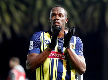 FILE PHOTO: Soccer Football - Central Coast Mariners v Central Coast Select - Central Coast Stadium, Gosford, Australia - August 31, 2018 Central Coast Mariners' Usain Bolt applauds the fans after the match REUTERS/David Gray/File Photo
