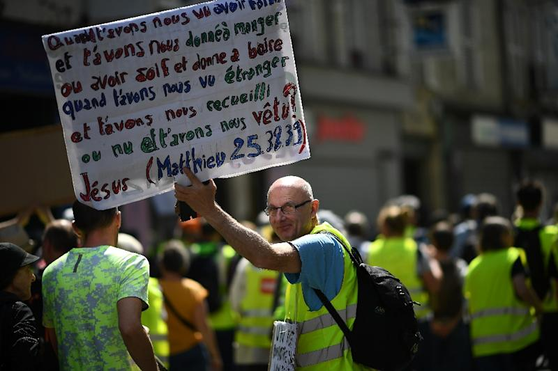Some demonstrators quoted passages from the Bible in the first protest after the Notre-Dame fire (Matthew 25:38:39) (AFP Photo/Anne-Christine POUJOULAT)