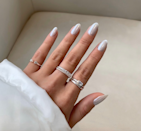 Pro tip: Match your rings to your nails for maximum impact.