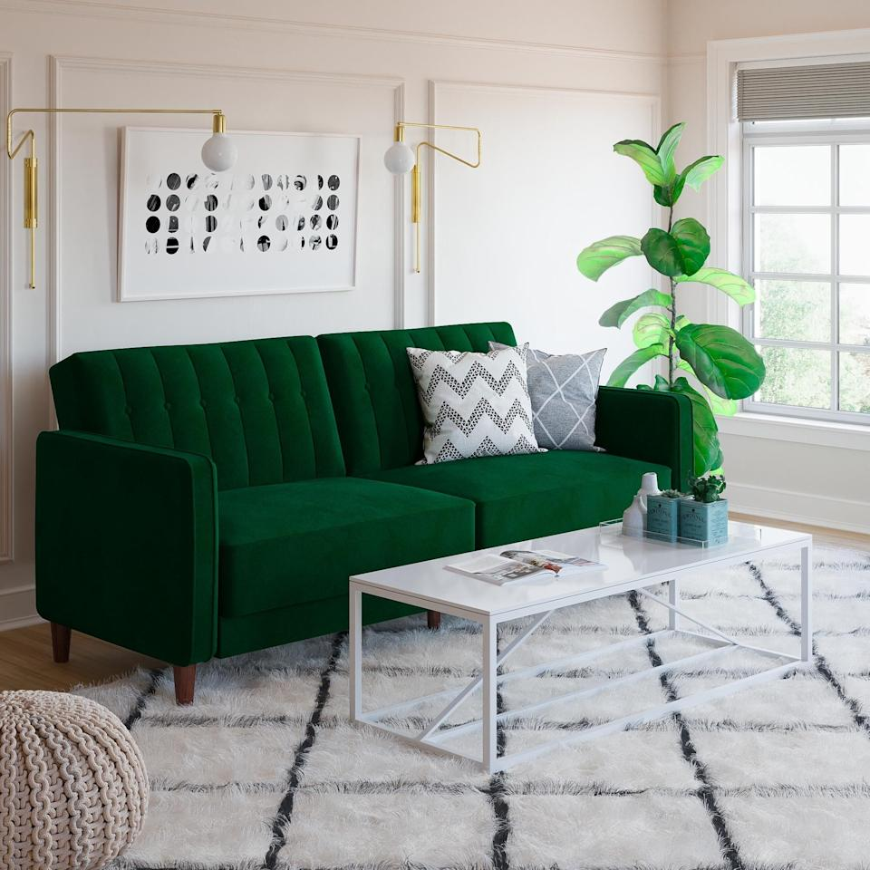 "<p>Make a statement with this green <a href=""https://www.popsugar.com/buy/DHP-Pin-Tufted-Transitional-Velvet-Futon-Couch-452087?p_name=DHP%20Pin%20Tufted%20Transitional%20Velvet%20Futon%20Couch&retailer=walmart.com&pid=452087&price=364&evar1=casa%3Aus&evar9=45912843&evar98=https%3A%2F%2Fwww.popsugar.com%2Fhome%2Fphoto-gallery%2F45912843%2Fimage%2F46672534%2FDHP-Pin-Tufted-Transitional-Velvet-Futon-Couch&list1=shopping%2Cfurniture%2Csmall%20space%20living%2Capartment%20living%2Chome%20shopping&prop13=mobile&pdata=1"" rel=""nofollow"" data-shoppable-link=""1"" target=""_blank"" class=""ga-track"" data-ga-category=""Related"" data-ga-label=""https://www.walmart.com/ip/DHP-Pin-Tufted-Transitional-Velvet-Futon-Couch-Multiple-Colors/930619421?athcpid=930619421&amp;athpgid=athenaItemPage&amp;athcgid=null&amp;athznid=PWVUB&amp;athieid=v0&amp;athstid=CS020&amp;athguid=9c475e07-53b-16aeaf4adf179a&amp;athena=true"" data-ga-action=""In-Line Links"">DHP Pin Tufted Transitional Velvet Futon Couch</a> ($364-$459).</p>"