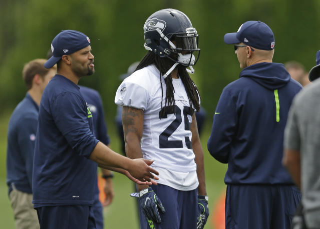 Richard Sherman is back with the Seahawks after an offseason of trade rumors. (AP)