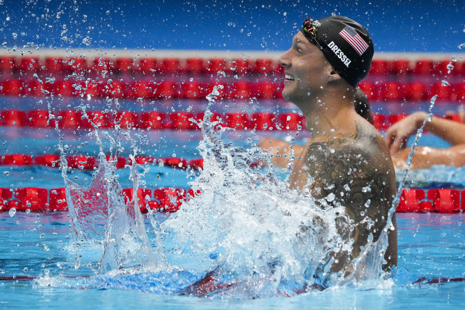 Caeleb Dressel, of the United States, celebrates after winning the men's 100-meter freestyle final at the 2020 Summer Olympics, Thursday, July 29, 2021, in Tokyo, Japan. (AP Photo/Charlie Riedel)