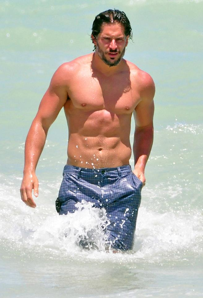 "Actor Joe Manganiello was pictured relaxing with a female and swimming in the ocean of Miami's South Beach. He was in town to promote his new upcoming movie 'Magic Mike', a major motion picture about male strippers, co-starring Matthew McConaughey and Channing Tatum. Joe's character in the movie is a stripper called Big Dick Richie, and he had to wear a thong, which he has reportedly described as feeling ""like a wedgie"". He also plays a werewolf in the popular HBO series 'True Blood'.