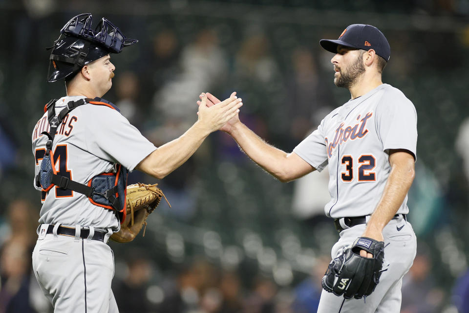SEATTLE, WASHINGTON - MAY 17: Jake Rogers #34 and Michael Fulmer #32 of the Detroit Tigers high five after defeating the Seattle Mariners 4-1 at T-Mobile Park on May 17, 2021 in Seattle, Washington. (Photo by Steph Chambers/Getty Images)