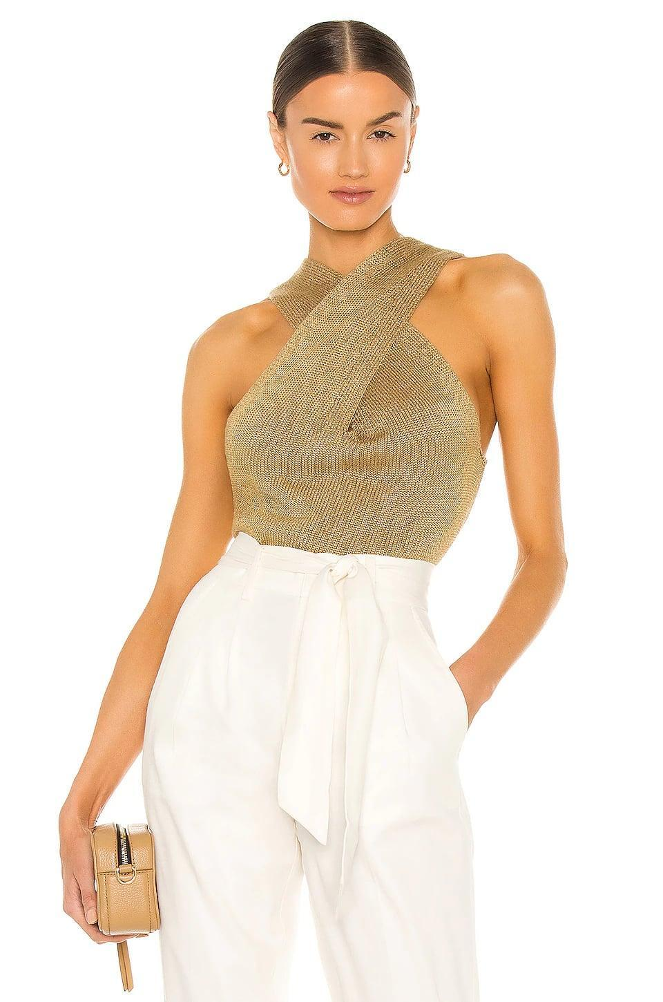 <p>Stay golden in this <span>Brochu Walker Ina Wrap Tank</span> ($288).</p>