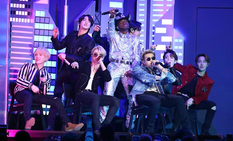 "Lil Nas X, background center, and members of BTS perform ""Old Town Road"" at the 62nd annual Grammy Awards on Sunday, Jan. 26, 2020, in Los Angeles."