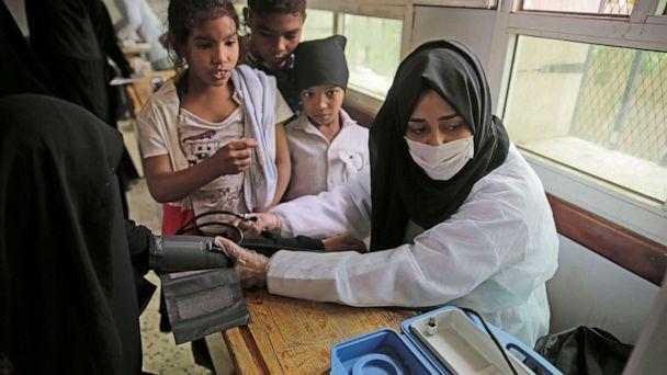 PHOTO: A volunteer doctor measures the blood pressure of a woman during a health check-up for the poor families amid the spread of coronavirus, July 8, 20202, at a school in Sanaa, Yemen. (Hani Al-Ansi/DPA via Getty Images)