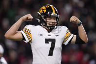 Iowa quarterback Spencer Petras reacts after a play against Maryland during the first half of an NCAA college football game, Friday, Oct. 1, 2021, in College Park, Md. (AP Photo/Julio Cortez)
