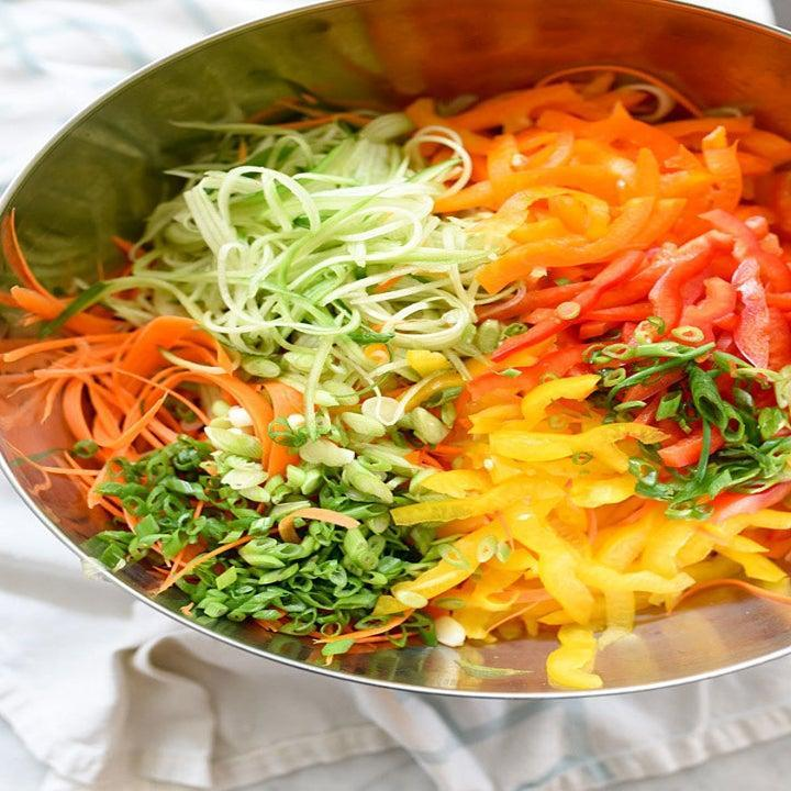 Julienned and chopped veggies in a bowl.
