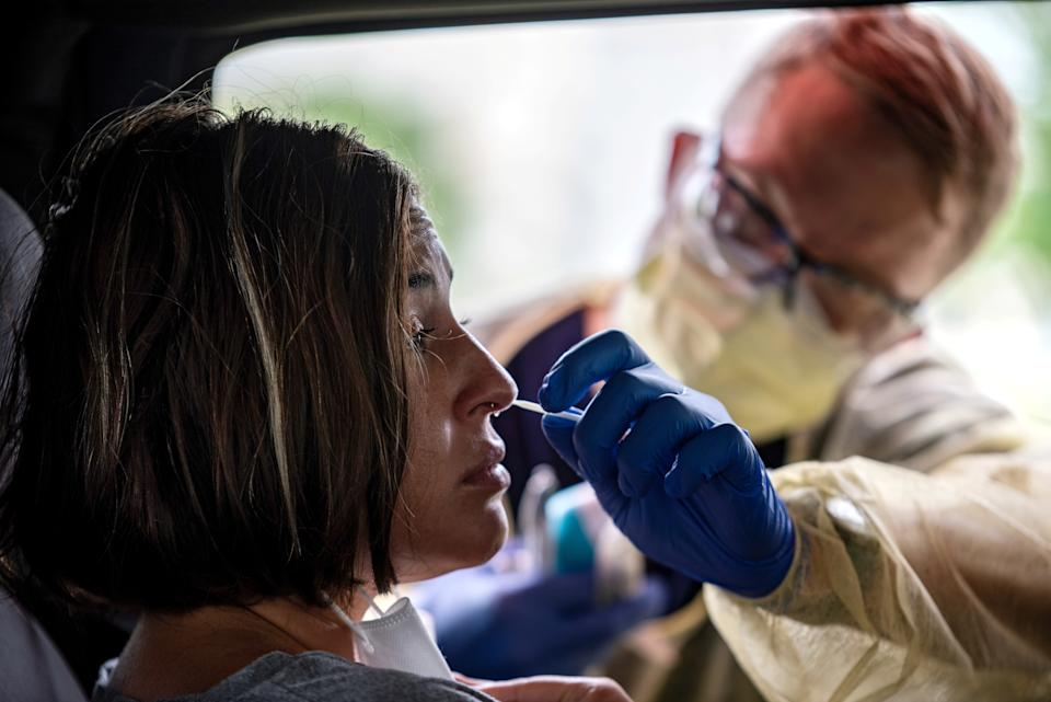 Atealla Betancourt is tested in a car for coronavirus disease (COVID-19) during an outbreak, in Austin, Texas, U.S., June 28, 2020. REUTERS/Sergio Flores     TPX IMAGES OF THE DAY