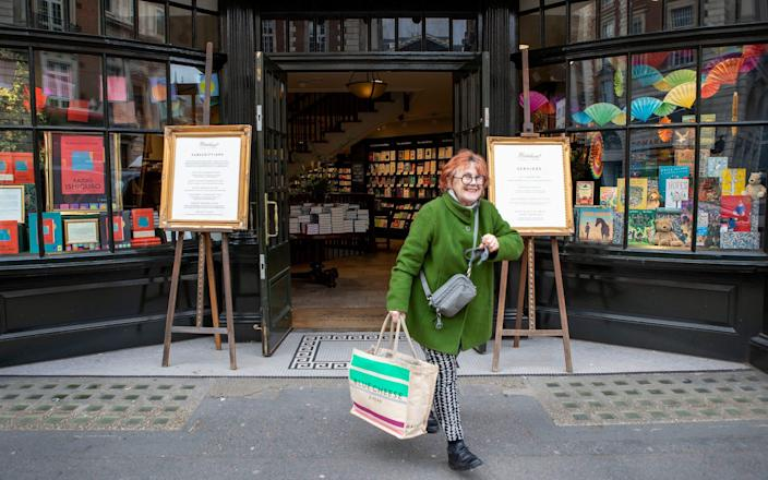 A happy customer leaving after a shopping spree - Rii Schroer