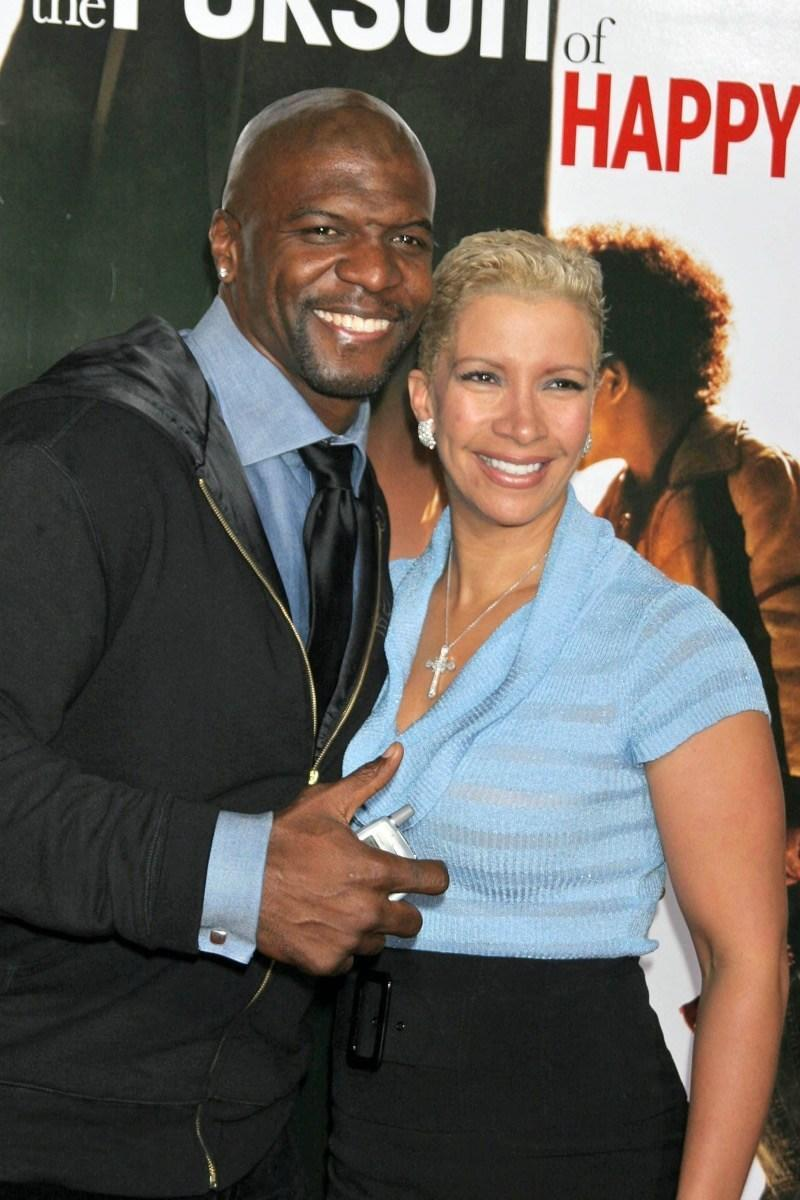 "WESTWOOD, CA - DECEMBER 07: Terry Crews and wife Rebecca at the premiere of ""The Pursuit of Happyness"" in Mann Village Theater December 07, 2006 in Westwood, CA."
