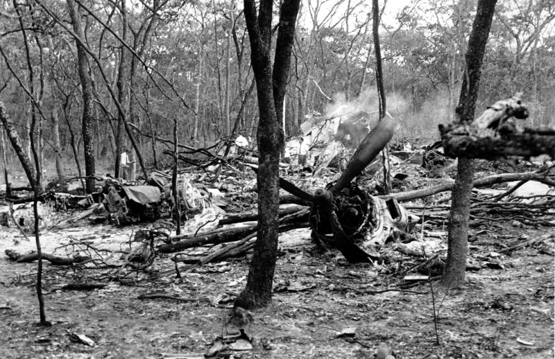 FILE - In this Sept. 19, 1961 file photo, searchers walk through the scattered wreckage of the DC6B plane carrying Dag Hammarskjold in a forest near Ndola, Zambia. America's National Security Agency may hold crucial evidence about one of the greatest unsolved mysteries of the Cold War _ the cause of the 1961 plane crash which killed United Nations Secretary-General Dag Hammarskjold, a commission which reviewed the case said Monday, Sept. 9, 2013. Widely considered the U.N.'s most effective chief, Hammarskjold died as he was attempting to bring peace to the newly independent Congo. The crash of his DC-6 aircraft in the forest near Ndola Airport in modern-day Zambia has bred a rash of conspiracy theories, many centering on some startling inconsistencies. (AP Photo)