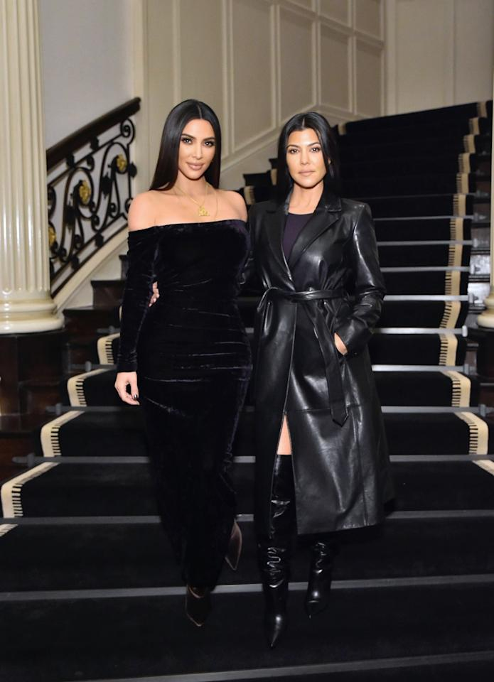 <p>What makes both Kim and Kourtney Kardashian's outfits so chic is the play of similar textures layered on top of each other. Both of them are wearing boots made in the same material as their dresses (and in Kourt's case, her jacket), a choice that makes their outfits feel seamless from head to toe. I'm personally a huge fan of Kim's velvet-on-velvet look because of how luxe it feels - and it's perfect for the holiday season. </p>