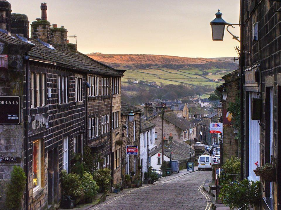"""<p>Home to the Bronte sisters and no doubt a heavy influence in English literature, Haworth in North Yorkshire is a charming village amongst the rolling Yorkshire moors. A long, steep cobbled street lined with old-fashioned curiosity shop types makes for picture-perfect winter scenes. </p><p><strong>READ MORE: </strong><a href=""""http://www.countryliving.co.uk/wildlife/countryside/a994/guide-to-the-ribble-valley/"""" rel=""""nofollow noopener"""" target=""""_blank"""" data-ylk=""""slk:Your ultimate guide to exploring the Ribble Valley"""" class=""""link rapid-noclick-resp"""">Your ultimate guide to exploring the Ribble Valley</a></p>"""