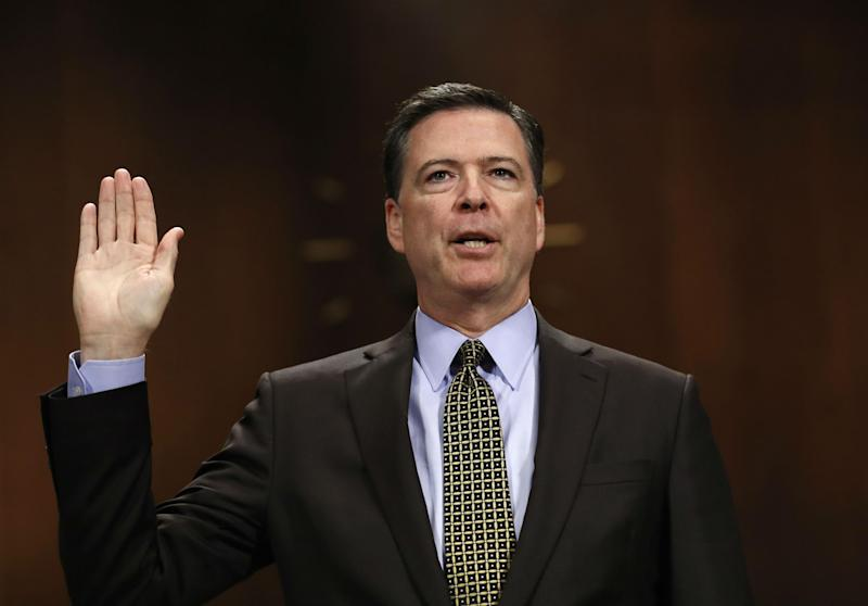 Mr Comey defended his two investigations into the presidential candidates: AP