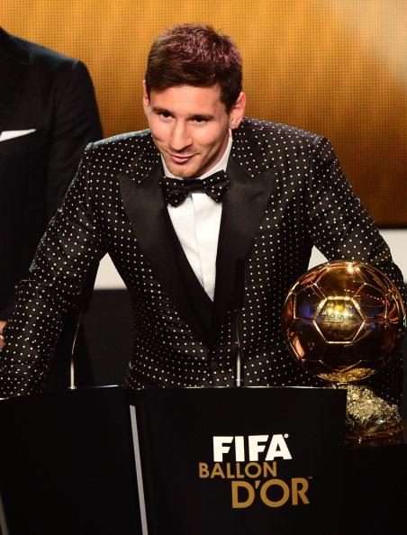 Barcelona's Argentinian forward Lionel Messi receives the FIFA Ballon d'Or award during the FIFA Ballon d'Or awards ceremony at the Kongresshaus in Zurich on January 7, 2013. AFP PHOTO / OLIVIER MORIN (Photo credit should read OLIVIER MORIN/AFP/Getty Images)