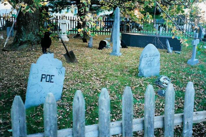 """<p>If you have zombies, you might want a graveyard for them to crawl out of. Stross used to make his homemade cemeteries out of Styrofoam. """"You could use an old cooler that's falling apart,"""" he says. """"You take a little saw, make your [headstone] shapes, and then you spray paint and then dry brush with some gray and black paint. Before you know it, you've got a full cemetery. Add that with your zombies that you made the night before, and you've got a neat little theme that's going to fill out your yard."""" <i>(Photo: Bud Stross)</i></p>"""