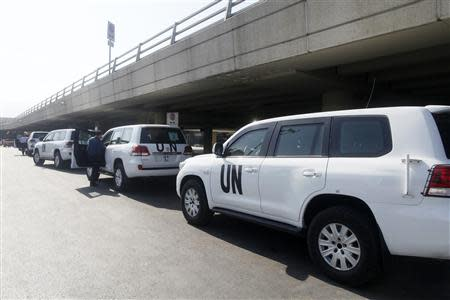 A convoy of cars of United Nations inspectors are seen arriving at Beirut airport August 31, 2013. REUTERS/Jamal Saidi
