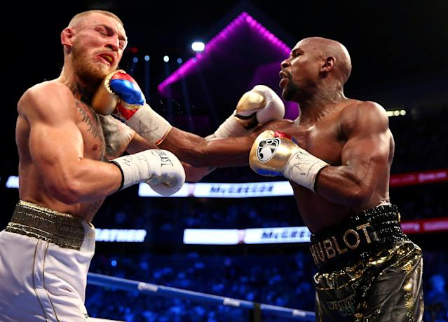 Floyd Mayweather Jr. and Conor McGregor in action during a bout at T-Mobile Arena in Las Vegas on August 26, 2017. (Reuters)