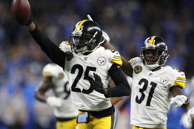 Oct 29, 2017; Detroit, MI, USA; Pittsburgh Steelers cornerback Artie Burns (25) celebrates with defensive back Mike Hilton (31) after picking up a fumble during the fourth quarter against the Detroit Lions at Ford Field. Mandatory Credit: Raj Mehta-USA TODAY Sports