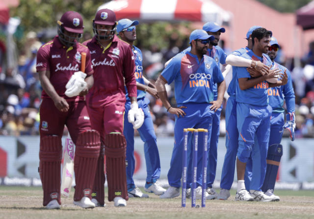 India's Bhuvneshwar Kumar, right, is congratulated after taking the wicket of West Indies' Evin Lewis, left, during the second Twenty20 international cricket match, Sunday, Aug. 4, 2019, in Lauderhill, Fla. (AP Photo/Lynne Sladky)