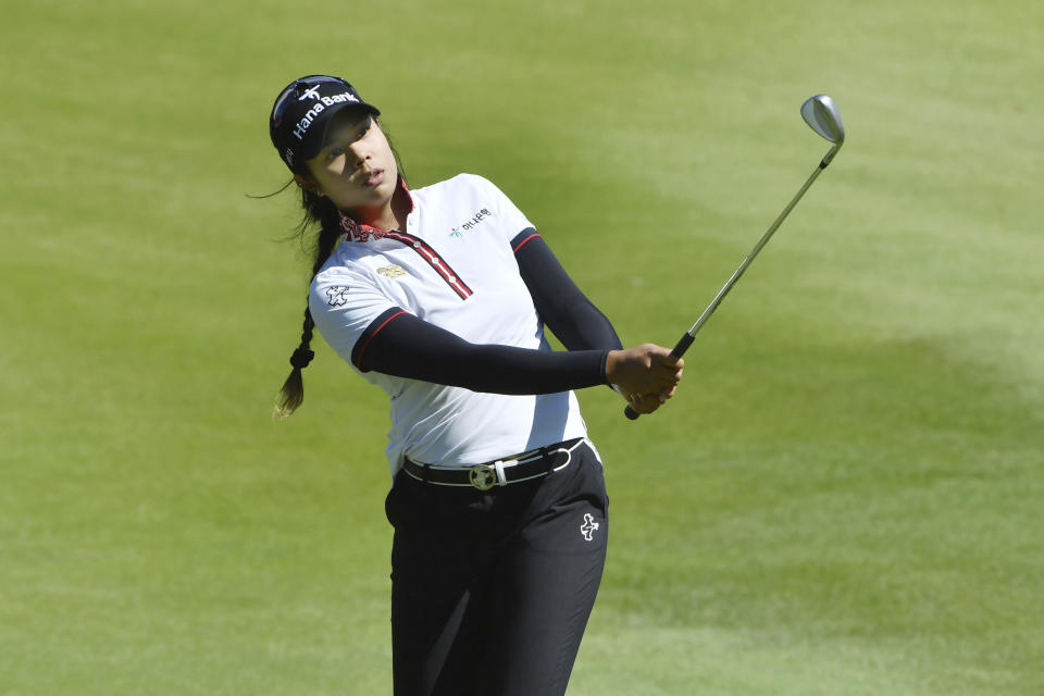 Patty Tavatanakit, of Thailand, chips onto the 18th green during the second round of the LPGA Arkansas Championship golf tournament, Saturday, Sept. 25, 2021, in Rogers, Ark. (AP Photo/Michael Woods)