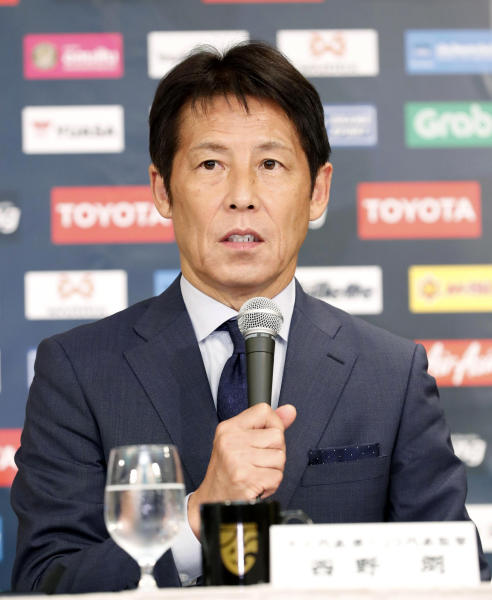 Former Japan manager Akira Nishino speaks during a press conference in Tokyo, Friday, July 19, 2019. Nishino was officially named head coach of the Thailand national and under-23 men's soccer teams on Wednesday. (Masanobu Kumagai/Kyodo News via AP)