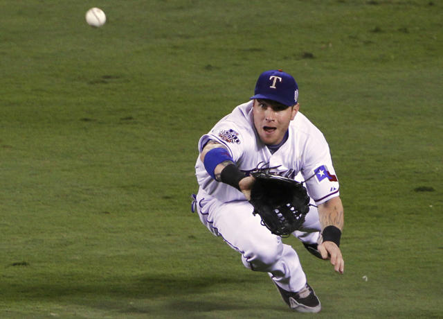 FILE - In this Oct. 31, 2010, file photo, Texas Rangers' Josh Hamilton dives to catch a fly ball by San Francisco Giants' Nate Schierholtz to end the second inning of Game 4 of baseball's World Series in Arlington, Texas. Hamilton will be inducted into the Rangers Hall of Fame on Aug. 17, 2019. (AP Photo/Mark Humphrey, File)