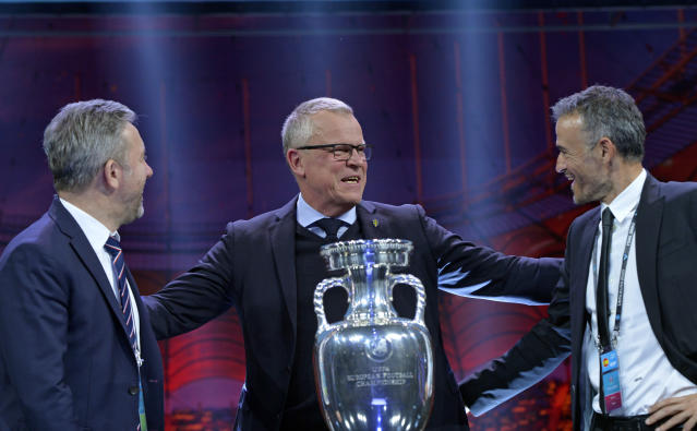 Poland coach Jerzy Brzeczek, Sweden coach Janne Andersson and Spain coach Luis Enrique, from left, react during the draw for the UEFA Euro 2020 soccer tournament finals in Bucharest, Romania, Saturday, Nov. 30, 2019. (AP Photo/Andreea Alexandru)