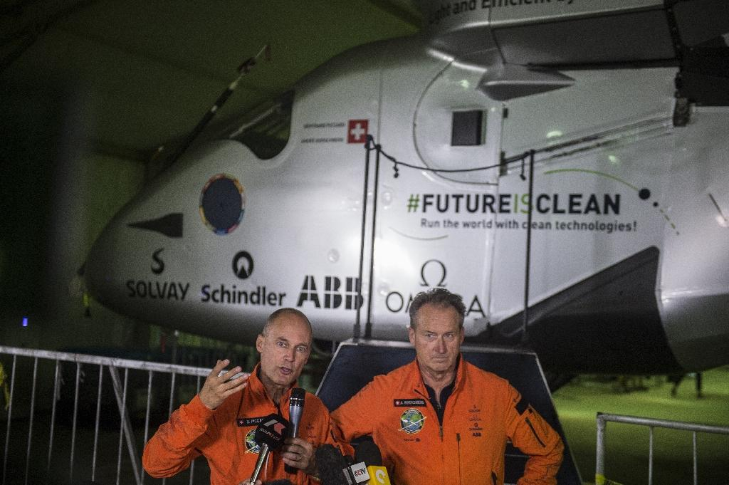 Swiss pilots Andre Borschberg (R) and Bertrand Piccard (L) took turns captaining the Solar Impulse 2 across four continents, two oceans and three seas without using any fuel (AFP Photo/Khaled Desouki)