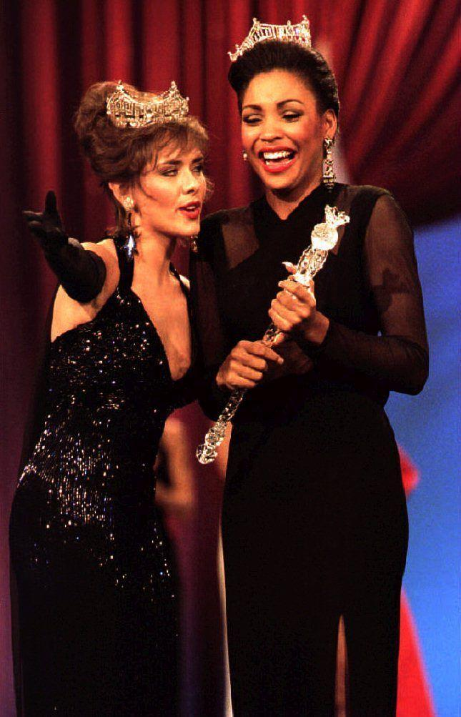 <p>Leanza Cornett of Florida, left, sparkled as she passed on the title to the following year's winner, Kimberly Aiken. Her sequined halter gown was so gorgeous, it almost stole the show. </p>