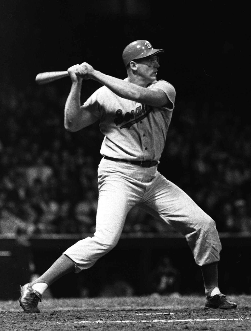 FILE - In this May 18, 1968, file photo, Washington Senators slugger Frank Howard connects for a ninth inning home run against the Detroit Tigers, in Detroit. They painted the seats white where Hondo's shots landed in the upper deck.(AP Photo/stf)