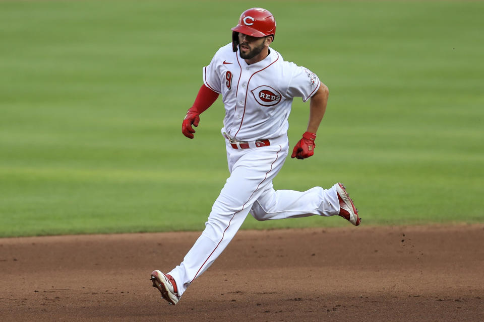 Cincinnati Reds' Mike Moustakas runs the bases after hitting a two-run home run during the fourth inning of the team's baseball game against the Chicago Cubs in Cincinnati, Wednesday, July 29, 2020. (AP Photo/Aaron Doster)