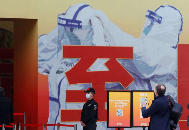 WHO team member Peter Ben Embarek visits an exhibition on how China fought the coronavirus in Wuhan