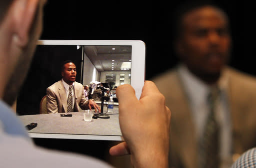 Alabama wide receiver Christion Jones, displayed on a tablet device, speaks to the media at the Southeastern Conference NCAA college football media days Thursday, July 17, 2014, in Hoover, Ala. (AP Photo/Butch Dill)