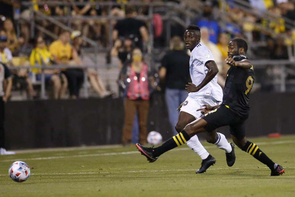 Chicago Fire's Jhon Espinoza, left, clears the ball past Columbus Crew's Kevin Molino during the second half of an MLS soccer match Saturday, June 19, 2021, in Columbus, Ohio. (AP Photo/Jay LaPrete)