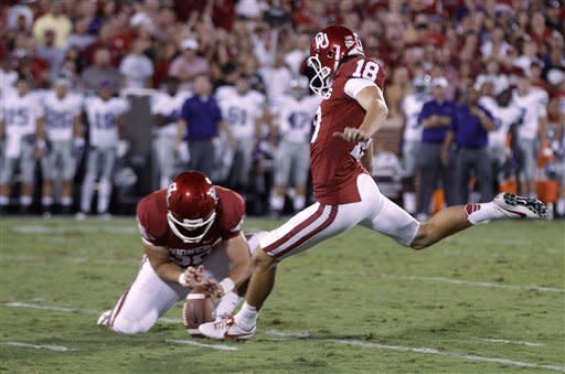 Oklahoma's Michael Hunnicutt (18) kicks a field goal against Kansas State in the second quarter of an NCAA college football game in Norman, Okla., Saturday, Sept. 22, 2012. (AP Photo/Sue Ogrocki)