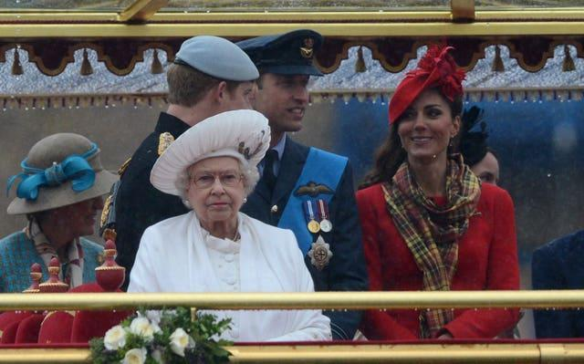 Queen with the Duke of Sussex and the Duke and Duchess of Cambridge on the royal barge Spirit of Chartwell during the Diamond Jubilee River Pageant. Adrian Dennis/PA Wire
