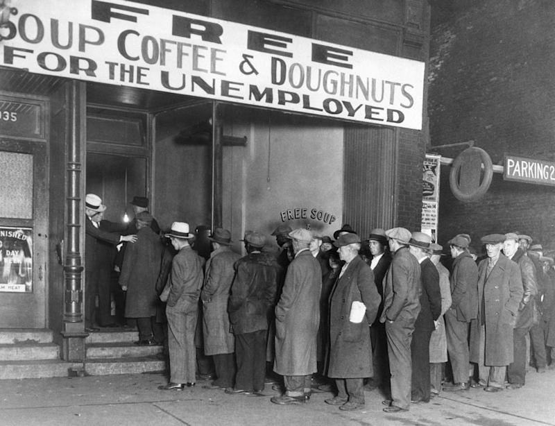 A crowd of men line up for free food during the Great Depression. Source: Getty Images