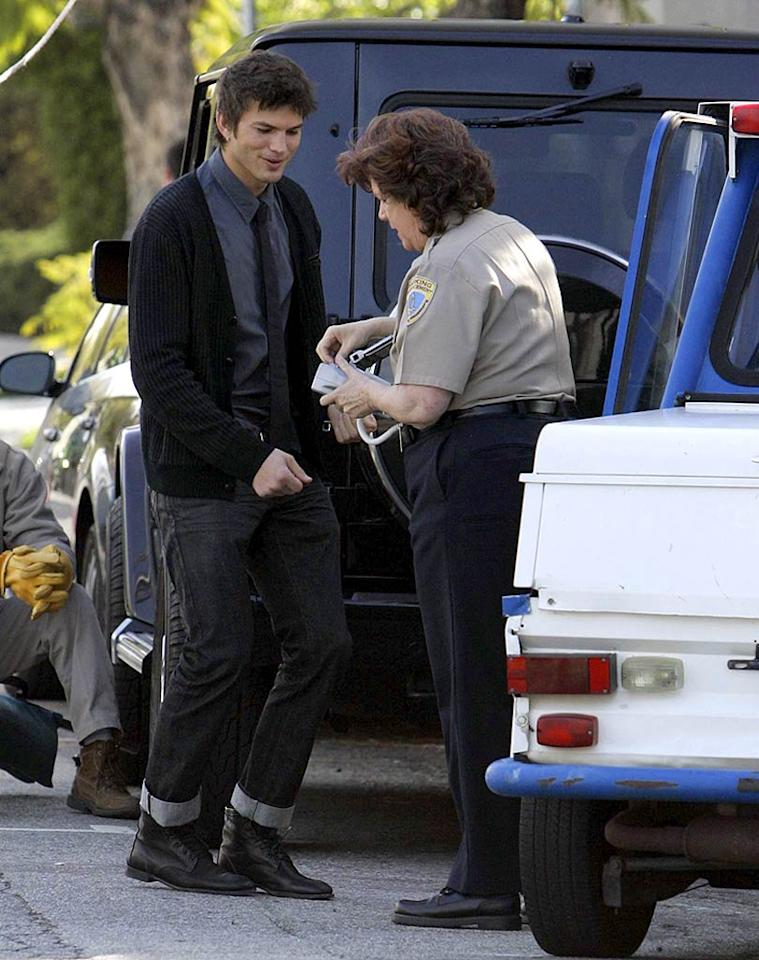 """Photographers were on hand to watch Ashton Kutcher try to charm his way out of a parking ticket on Wednesday. However, the incident may have been part of his new prank show called """"Pop Fiction."""" Kutcher has reportedly enlisted his fellow celebrities to stage outrageous events in order to expose how gullible the media is. APG/<a href=""""http://www.x17online.com"""" target=""""new"""">X17 Online</a> - March 4, 2008"""