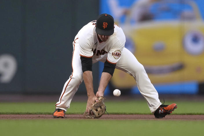 San Francisco Giants third baseman Jason Vosler can't make the stop on a grounder hit by Los Angeles Dodgers' Justin Turner during the fourth inning of a baseball game Wednesday, July 28, 2021, in San Francisco. Turner was safe at first. (AP Photo/Tony Avelar)