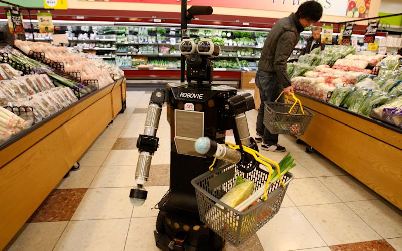 Osaka trials social-distancing robot to replace staff during pandemic