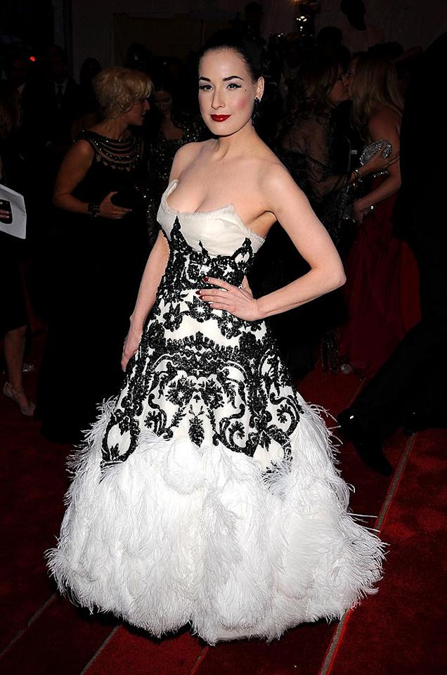"Dita Von Teese donned a black-and-white embroidered dress that was finished off with cascading feathers. Perhaps the fashion trailblazer was inspired by the infamous swan snafu Bjork wore to the Oscars in 2001? Dimitrios Kambouris/<a href=""http://www.wireimage.com"" target=""new"">WireImage.com</a> - May 5, 2008"