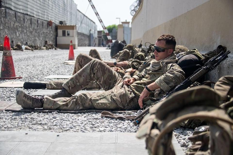 A member of the UK Armed Forces, who continue to take part in the evacuation of entitled personnel, taking a rest at Kabul airport (LPhot Ben Shread/MoD/PA) (PA Media)