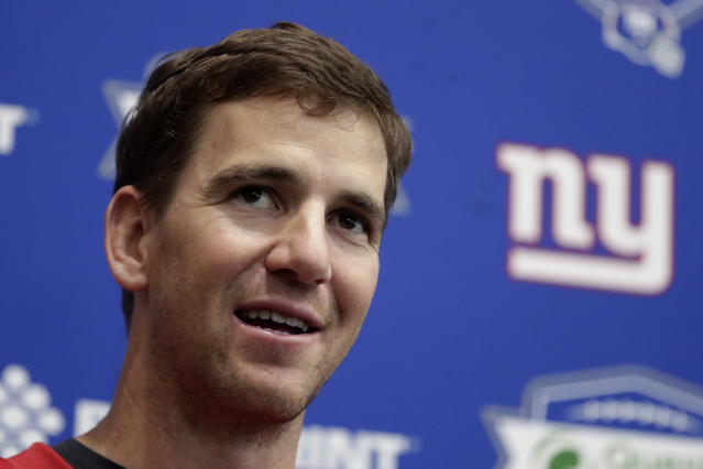 "FILE - In an April 25, 2018 file photo, New York Giants quarterback Eli Manning speaks to reporters during NFL football training camp, in East Rutherford, N.J. Jury selection is scheduled to begin on Monday, May 14, 2018, in a New Jersey memorabilia dealer's lawsuit that accuses New York Giants quarterback Eli Manning of conspiring with the team's equipment staff to sell bogus ""game-used"" helmets to unsuspecting collectors as part of a long-running scam.(AP Photo/Julio Cortez, File)"