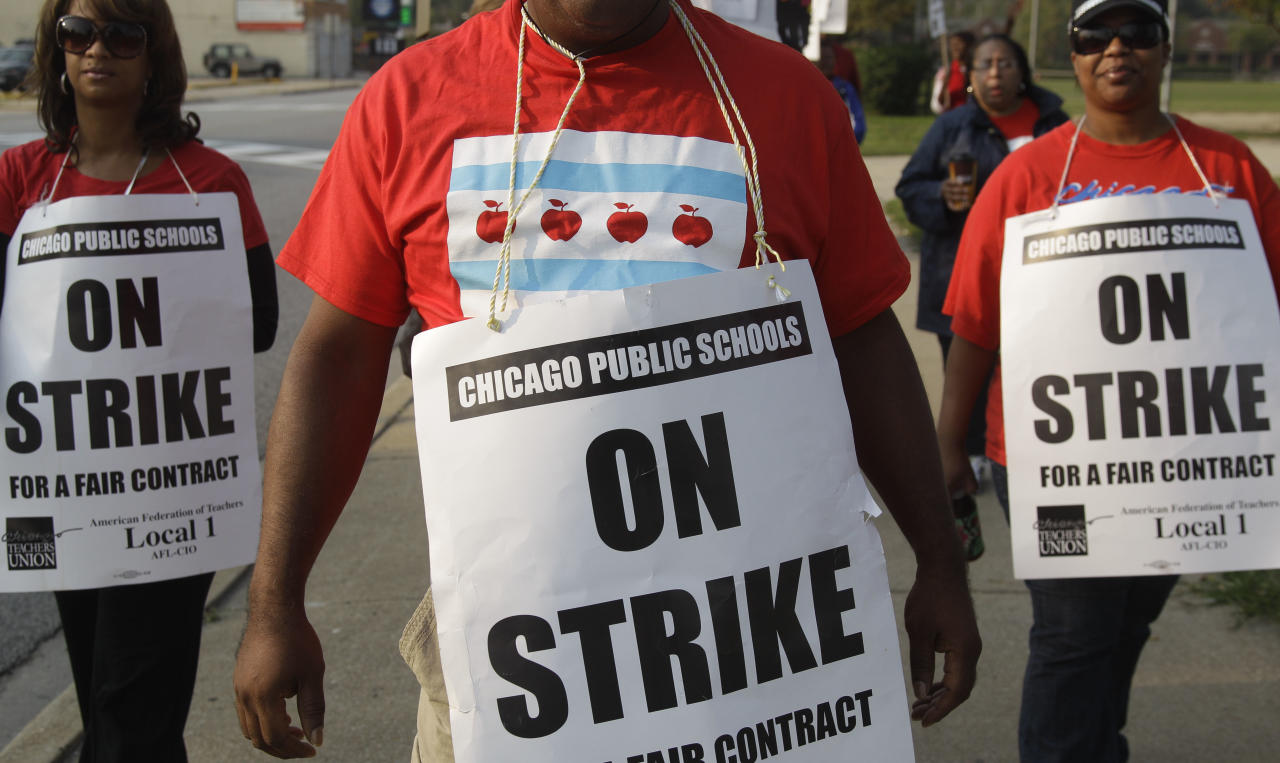 Smaller, more subdued groups of teachers picket outside Morgan Park High School in Chicago, Monday, Sept. 17, 2012, as a strike by Chicago Teachers Union members heads into its second week. Mayor Rahm Emanuel said he will seek a court order to force the city's teachers back into the classroom. (AP Photo/M. Spencer Green)