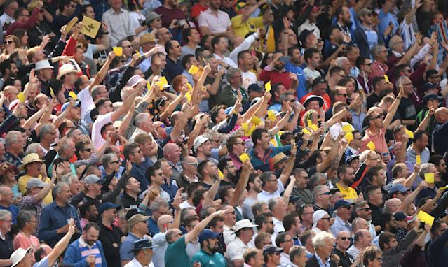 A group of fans holding up sandpaper to the Australian team. (Photo by Stu Forster/Getty Images)